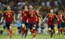 Spain's Ramos and his teammates run towards Navas after he scored the winning penalty goal against Italy in Fortaleza