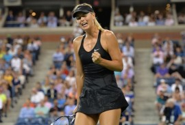 epa04368699 Maria Sharapova, of Russia, reacts to winning a point against Maria Kirilenko, of Russia, during the 2014 US Open Tennis Championship at the USTA National Tennis Center in Flushing Meadows, New York, USA, 25 August 2014. The US Open runs until 08 September, a 15-day schedule.  EPA/JUSTIN LANE