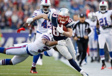 Nov 11, 2012; Foxborough, MA, USA; New England Patriots wide receiver Wes Welker (83) runs the ball against Buffalo Bills free safety Jairus Byrd (31) during the second half at Gillette Stadium. The Patriots defeated the Bills 37-31. Mandatory Credit: David Butler II-US PRESSWIRE
