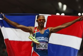 LONDON, ENGLAND - AUGUST 06:  Felix Sanchez of Dominican Republic celebrates after winning the gold medal in the Men's 400m Hurdles final on Day 10 of the London 2012 Olympic Games at the Olympic Stadium on August 6, 2012 in London, England.  (Photo by Hannah Johnston/Getty Images)