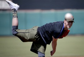 Pitcher Tim Lincecum throws for MLB baseball scouts, Friday, May 6, 2016, at Scottsdale Stadium in Scottsdale, Ariz. The former two-time Cy Young award winner is currently a free agent working his way back from hip surgery. (AP Photo/Matt York)