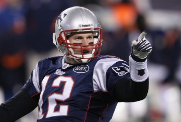 FOXBORO, MA - JANUARY 14:  Tom Brady #12 of the New England Patriots reacts after he threw a 19-yard touchdown pass to Rob Gronkowski #87 in the second quarter against the Denver Broncos during their AFC Divisional Playoff Game at Gillette Stadium on January 14, 2012 in Foxboro, Massachusetts.  (Photo by Elsa/Getty Images) ORG XMIT: 137108443