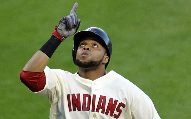 Aug 24, 2013; Cleveland, OH, USA; Cleveland Indians designated hitter Carlos Santana (41) celebrates his two-run home run in the first inning against the Minnesota Twins at Progressive Field. Mandatory Credit: David Richard-USA TODAY Sports